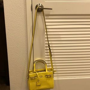 A yellow crossbody bag from Kate spade.
